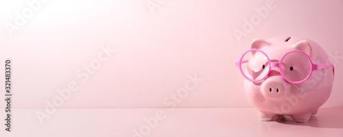 Fototapeta Pink piggy Bank on a pink background obraz