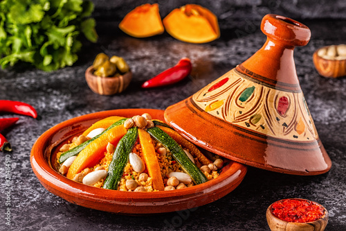 Fototapeta Vegetable tagine with almond and chickpea couscous. obraz