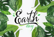 Leinwandbild Motiv Text EARTH DAY and fresh tropical leaves on white background