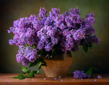 Still life with a bouquet of lilacs on the table