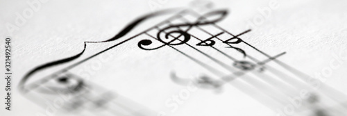 Musical notes printed on paper sheet - 321492540