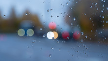 Raindrops On The Glass Against...