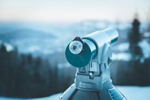Future And Inspiration Concept: Tourist Binocular, Landscape In Blurry Background. Wintertime