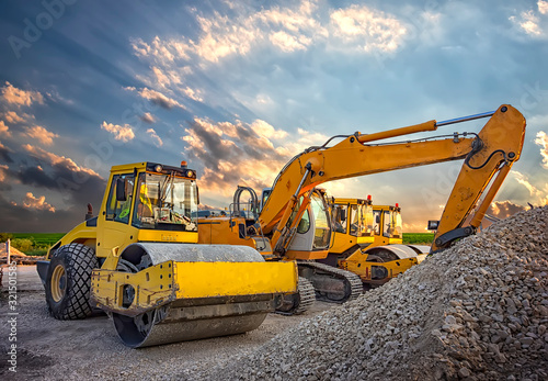 Wallpaper Mural Parked drum roller and excavators at the construction site, after work
