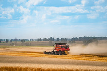 Combine Harvester In Action On The Field. Combine Harvester. Harvesting Machine For Harvesting A Wheat Field.