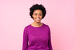 African american woman over isolated pink background laughing