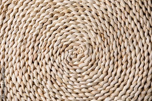 Obraz Straw wicker beige eco friendly spiral abstract background copy space - fototapety do salonu