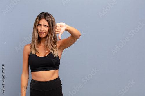 Fotografie, Tablou young pretty woman feeling cross, angry, annoyed, disappointed or displeased, sh