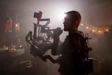 Cameraman At Work On Movie Set