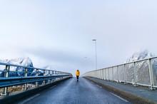 Tourist Crossing A Bridge At Hamnoy, Lofoten, Norway