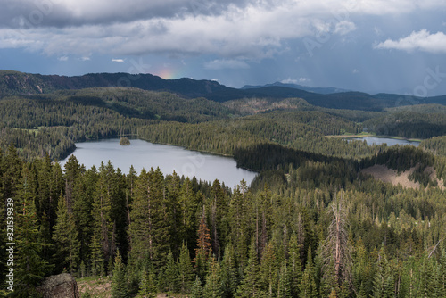 View Point on Grand Mesa National Forest Colorado has over 300 lakes. Partial Rainbow above Island Lake, which is one of the more popular destinations on the Grand Mesa.