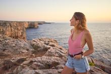 Young Woman Enjoying Sunset At...