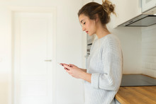 Young Woman Using Smartphone At Home