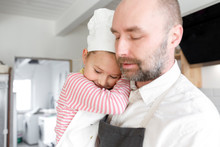 Father And Daughter Cooking In The Kitchen