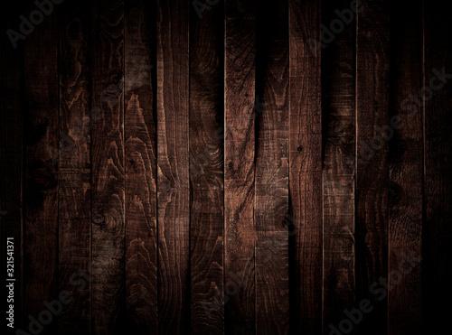 Photo Textura de tábuas de madeira marrom escura alinhadas na vertical.