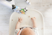 Robot Hand Giving Pacifier To ...