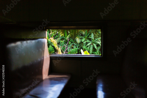 Interior of a passenger train carriage in Sri Lanka. Old and dirty wagon