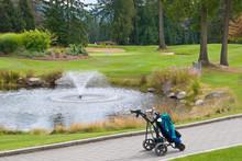 A Golf Bag On Three Wheel Golf Cart Over A Beautiful Pond.