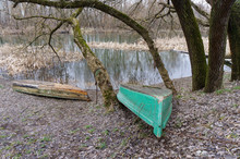 Two Old Fishing Boats Lie On T...