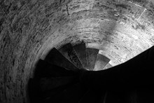 Black And White Photograph Of Some Spiral-shaped Stone Stairs