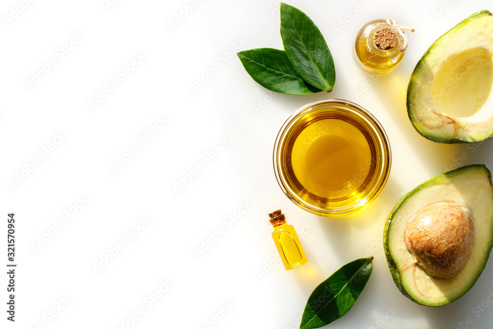 Fototapeta Avocado oil for healthy skin and hair on a white background.