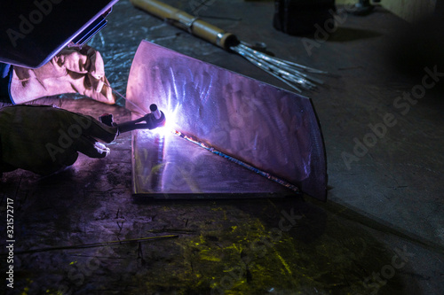 Photo Welding of stainless steel by electric arc welding in argon shielding gas