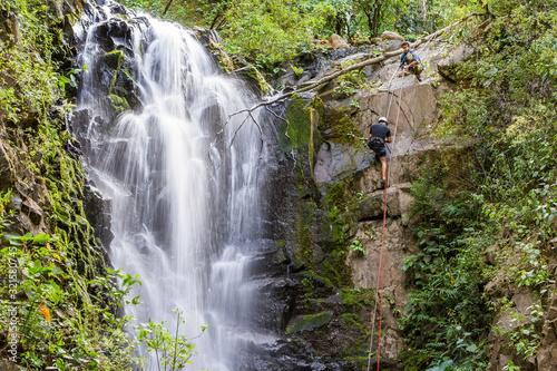 rappelling down a waterfall Wallpaper Mural