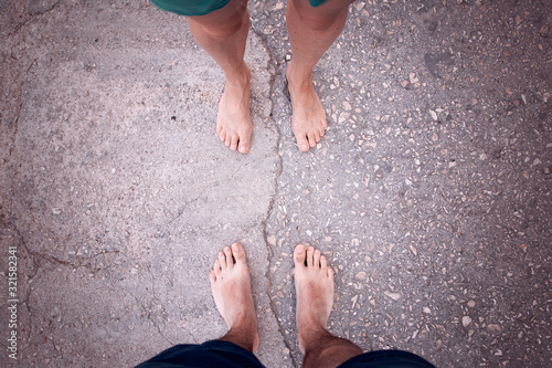 Point of view of a man and woman bare foot. Relationship concept. Canvas Print
