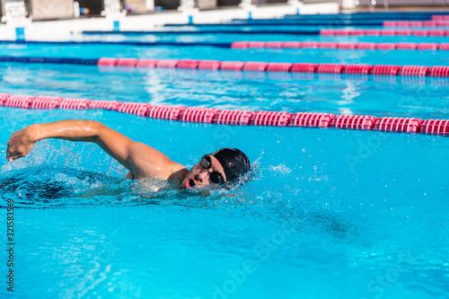 Valokuvatapetti Swimmer man sport training at swimming pool
