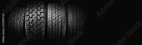 Fototapeta Car tires on black background for copy space obraz