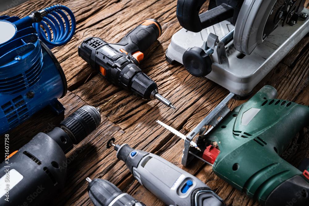 Fototapeta Power Tools On Wooden Desk
