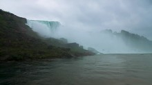 Couple Under Waterfall At Niag...