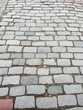 city street paved with colorful cobblestones pavement