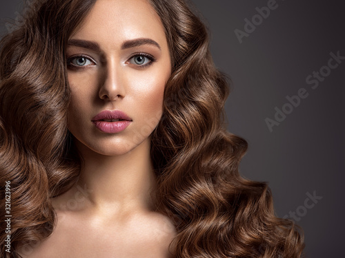 Fotografie, Obraz Beautiful woman with long brown hair.