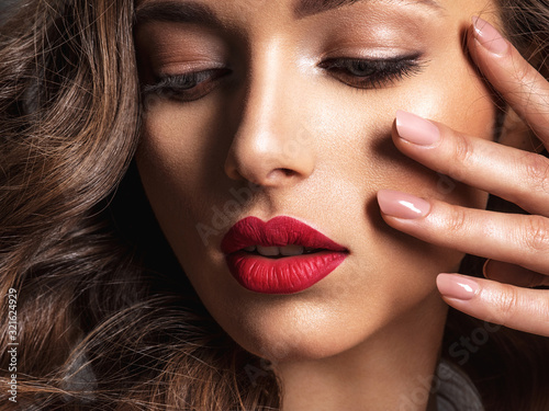 Fototapeta Beautiful face of young woman with red lipstick