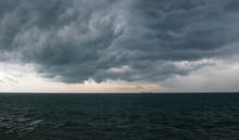 The Calm Before The Storm. Dark Dense Clouds Over The Wavy Sea