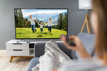 Woman Watching TV While Relaxi...