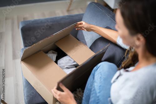Fototapeta Woman Opening Delivered Parcel