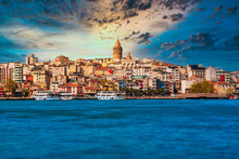 Galata Tower In Istanbul City Of Turkey. View Of The Istanbul City Of Turkey With Bosphorus, Seagulls And Boats At Bright Sky And Sunset Or Night.
