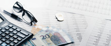 Close-up Banner Pen Calculator And Money On Financial Report - Business Accounting Concept