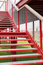 Red Steps Of A Metal Staircase...