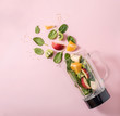 Leinwandbild Motiv Smoothie ingredients in mixer, smoothie preparation with spinach, apple, orange, kiwi, healthy eating, detox and nutritional consultation concept