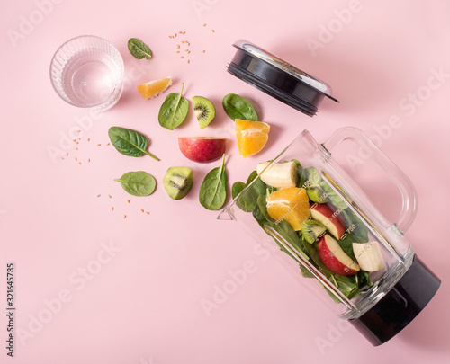 Smoothie ingredients in mixer, smoothie preparation with spinach, apple, orange, Wallpaper Mural