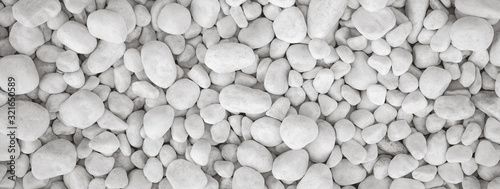 Photo White pebbles stone for background.