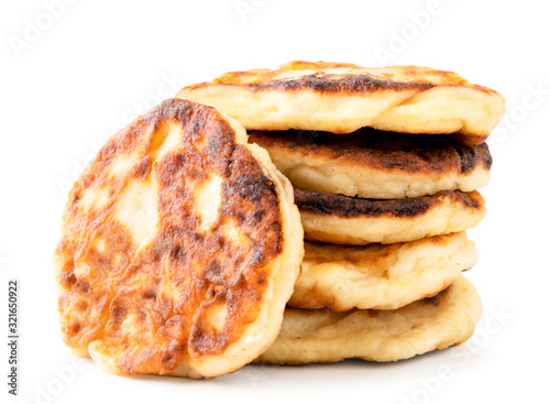 Fototapeta Cottage cheese pancakes in a close-up stack. Isolated on a white obraz