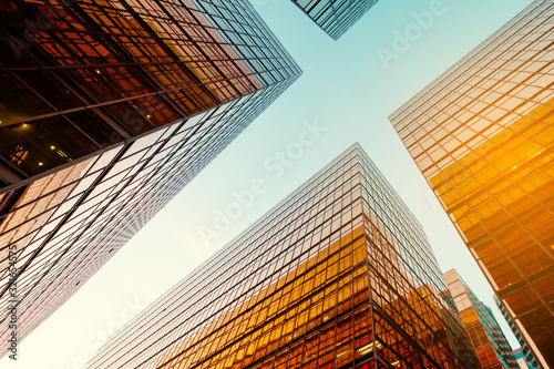 Obraz office buildings and blue sky in business district - fototapety do salonu