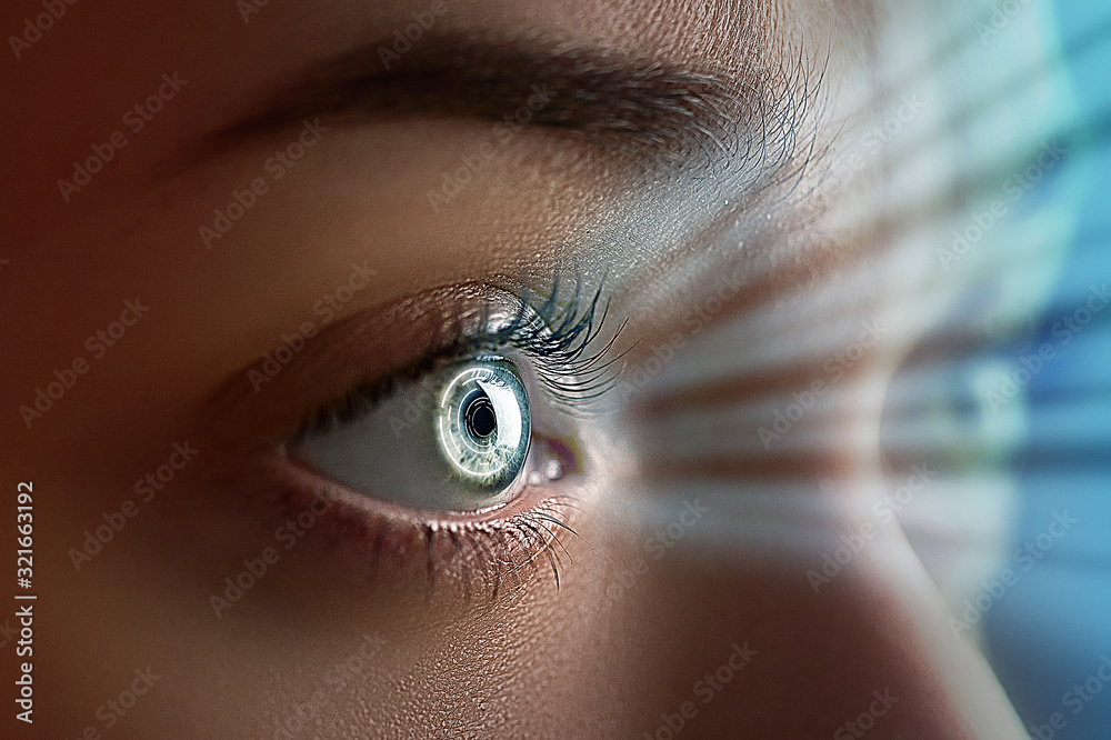 Fototapeta Female eye close up with smart contact lens with digital and biometric implants to scanning the ocular retina. Future concept and hi tech technology for scans to face eye identification