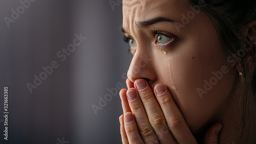 Fotografía Sad unhappy grieving crying woman with tears eyes closeup