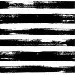 Black seamless pattern from thick horizontal abstract long textured brush strokes on a white background