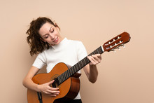 Young Woman With Guitar Over Isolated Background